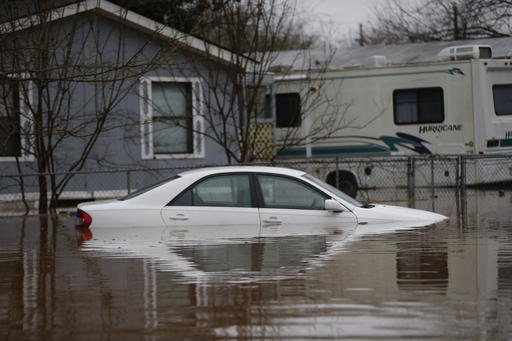 (AP Photo/Gerald Herbert). A car is seen partially submerged during rising floodwater at the Pecan Valley Estates trailer park in Bossier City, La., Wednesday, March 9, 2016.