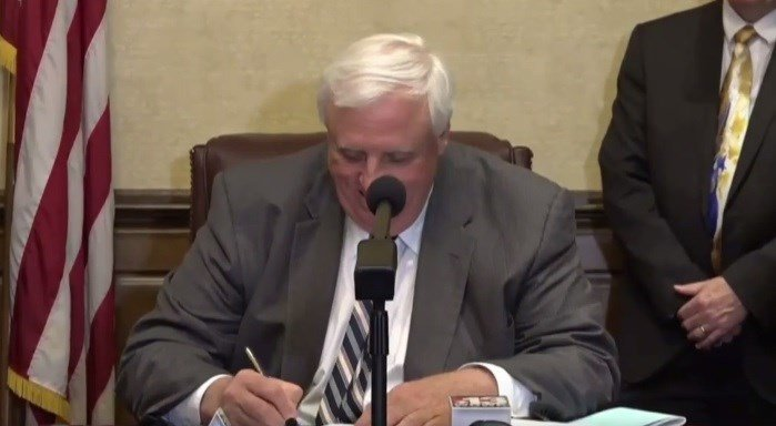 Gov. Jim Justice signs the Medical Cannabis Act on Wednesday making some forms of the drug available to qualifying patients in June 2018
