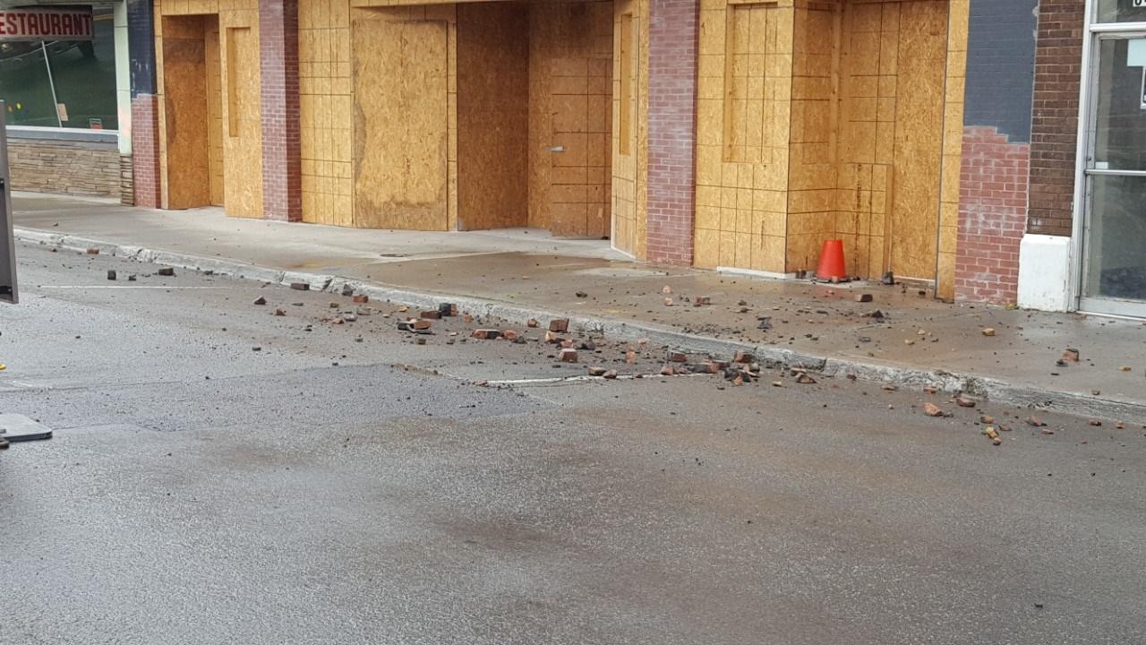 Debris and bricks left in the road