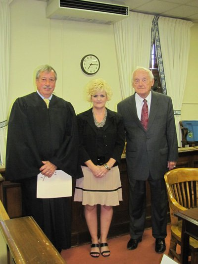 Livesay and Loudermilk pose for a photo with the judge after Loudermilk assumes the County Clerk position.