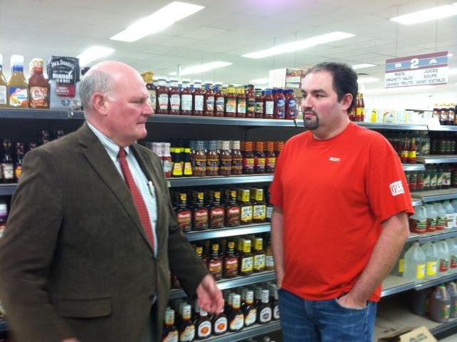 Oak Hill City Manager Bill Hannabass, left, and Grants co-owner Ron Martin