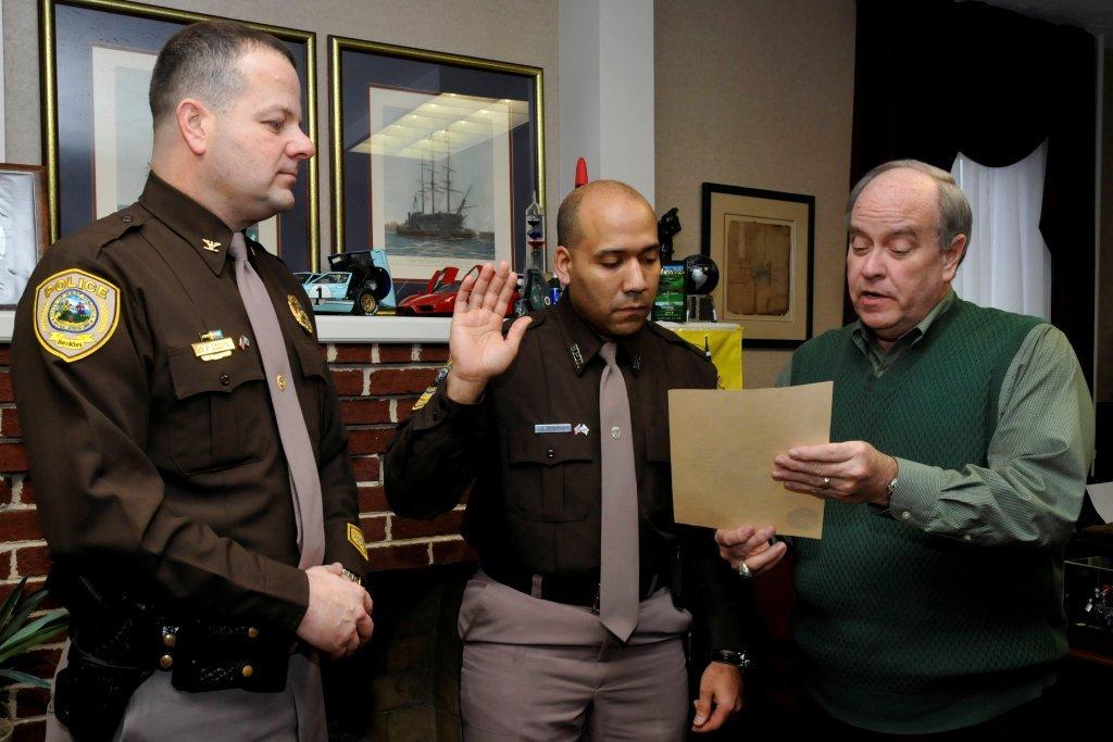 Officer Joseph J. Stewart being sworn in by Mayor Emmitt S. Pugh