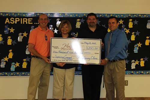 Josh Jones of Hospice of Southern WV is presented a check for $1,200 by Penny Carrico, Principal, Mark Campbell, Music Teacher, and Josh Grant, Assistant Principal of Shady Spring Elementary School.