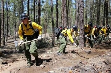 AP Photo/Cronkite News, Connor Radnovich). In this 2012 photo provided by the Cronkite News, the Granite Mountain Hotshot crew clears a fire line through the forest.
