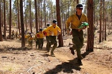 (AP Photo/Cronkite News, Connor Radnovich). In this 2012 photo provided by the Cronkite News, members of the Granite Mountain Hotshots run during training on the use of emergency fire shelters