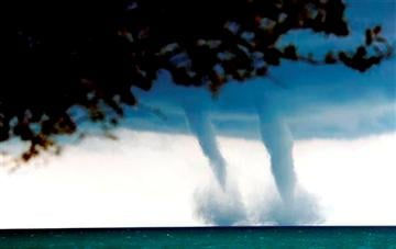 (AP Photo/The Kenosha News, Kevin Poirier). A pair of water spouts form on Lake Michigan southeast of Kenosha, Wis. on Thursday, Sept. 12, 2013.