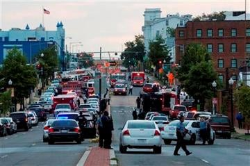 (AP Photo/Jacquelyn Martin). Police work the scene on M Street, SE in Washington, where a gunman was reported at the Washington Navy Yard in Washington, on Monday, Sept. 16, 2013.