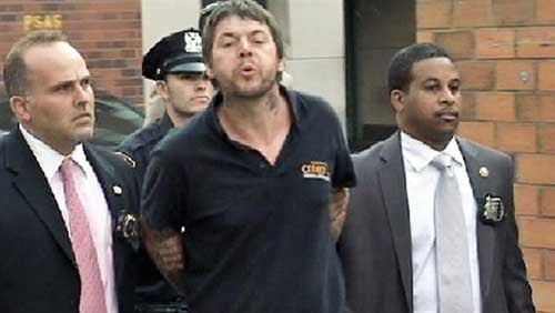 File image: David Mitchell spits at reporters following his arrest in New York - From NBC 4 New York
