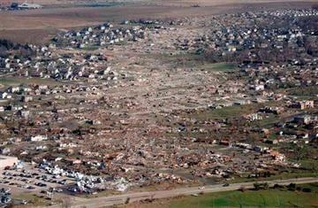 (AP Photo/Charles Rex Arbogast, File). FILE - This Nov. 18, 2013 aerial file photo shows the path of a tornado that hit the western Illinois town of Washington on Sunday, Nov. 17.