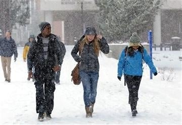 (AP Photo/Reno Gazette-Journal, Andy Barron). UNR students walk to class on the university campus during the first snow fall of the season on Tuesday, Dec. 3, 2013, in Reno, Nev.
