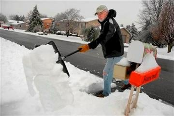 (AP Photo/The Journal, Ron Agnir). John Edgar shovels his sidewalk clear of the 6 inches of snowfall along Hermitage Drive in Martinsburg, W.Va., Monday, Dec. 9, 2013.