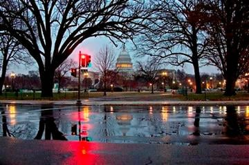 (AP Photo/J. Scott Applewhite). Snow and freezing rain fall on the Capitol in Washington, early Tuesday, Dec. 10, 2013, prompting the federal government to close for the wintry weather.