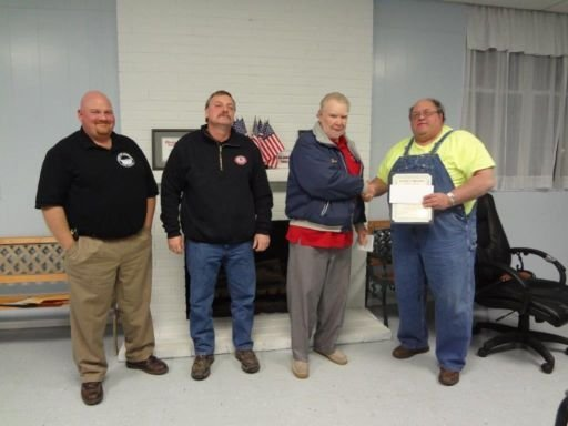 Marlinton Mayor Joe Smith presents the certificate of appreciation and donation to Council Member and Assistant Fire Chief Charles M. Lobban, Jr.