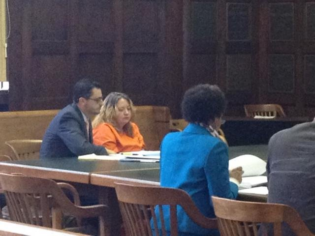 Kimberly Cox, center, in court Monday; photo by Kristen Conner