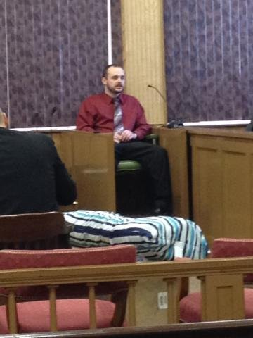 Earl Click on the witness stand Tuesday; photo by Kristen Conner