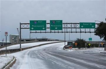 (AP Photo/AL.com, Sharon Steinmann). Bridges are frozen and ice covers downtown Mobile, Ala., as temperatures remain below freezing on Wednesday Jan. 29, 2014.