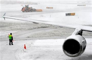 (AP Photo/Matt York). A snow plow clears the runway Monday, Feb. 3, 2014 at Newark Liberty International Airport in Newark, NJ.