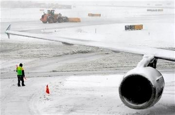 (AP Photo/Matt York). A snow plow clears the runway Monday, Feb. 3, 2014 at Newark Liberty International Airport in Newark, NJ.