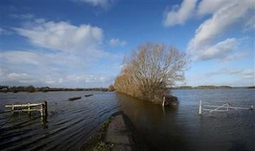 (AP Photo/Alastair Grant). In this photo taken Sunday Feb. 2, 2014, floodwater from the River Parrett blocks a road from Thorney to Barrington in Somerset, England.