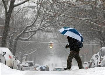 (AP Photo/Mike Groll, File). FILE - This Jan. 5, 2014 file photo shows a pedestrian walking in the snow in the Center Square neighborhood in Albany, N.Y.