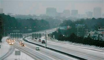 (AP Photo/Mary Ann Chastain). Ice and snow cover Interstate 26, early Wednesday, Feb. 12, 2014, in Columbia, S.C.
