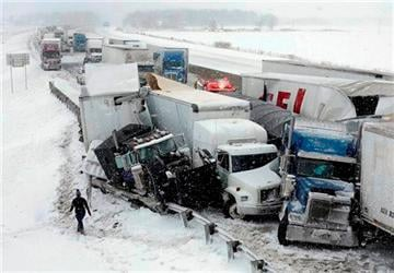 (AP Photo/The Toledo Blade, Jeremy Wadsworth). A multi-vehicle accident in the eastbound lane of the Ohio Turnpike near the County Road 268 overpass ties up traffic Wednesday, March 12, 2014, near Clyde, Ohio.