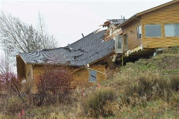 (AP Photo/Jackson Hole News and Guide, Angus M. Thuermer Jr). A house breaks apart as a slow-moving landslide in Jackson, Wyo. advances downhill on Friday, April 18. 2014.