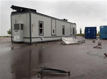 (AP Photo/Ed Andrieski). A damaged office trailer is flipped over after if was blown over by a reported tornado at the Blackstone County Club in southeast Aurora, Colo., on Sunday, June 8, 2014.