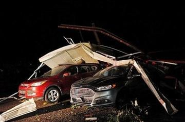 (AP Photo/Argus Leader, Joe Ahlquist). Damaged vehicles at Springs Auto after a tornado tore through the area on Wednesday, June 18, 2014, in Wessington Springs, S.D.