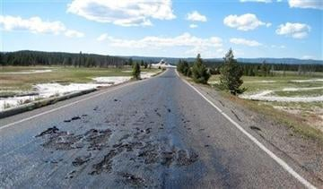 (AP Photo/Yellowstone National Park). This undated photo provided by the National Park Service shows damage to a Yellowstone National Park road caused by the park's ever-changing thermal features in the park in Wyoming.