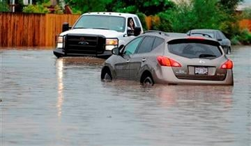 (AP Photo/Greeley Tribune, Jim Rydbom). Stranded cars sit near Garden and Cornerstone Drives after people were forced to leave them due to high waters in Windsor, Colo, on Tuesday, July 29, 2014.