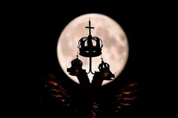 (AP Photo/Alexander Zemlianichenko). The supermoon rises behind the golden double-headed eagle, the National Emblem of the Russian Federation at Red Square in Moscow, Russia, Monday, Aug. 11, 2014.