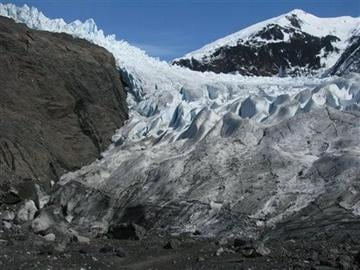 (AP Photo/Becky Bohrer, File). FILE - This April 19, 2013, file photo shows the Mendenhall Glaicer where it spills over the mountains above Mendenhall Lake in Juneau, Alaska.