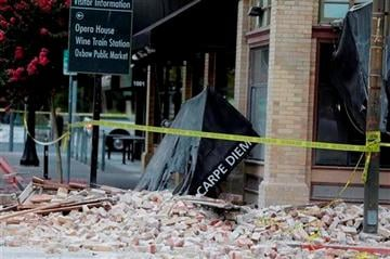 (AP Photo/Eric Risberg). Bricks and rubble cover the sidewalk in front of a heavily damaged building following an earthquake Sunday, Aug. 24, 2014, in Napa, Calif.