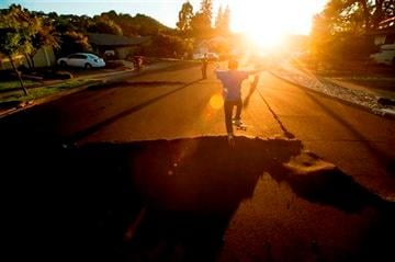 (AP Photo/Noah Berger). Skateboarder Bayley Lorenzen, 12, launches himself off buckled pavement in Napa, Calif., following an earthquake Sunday, Aug. 24, 2014.