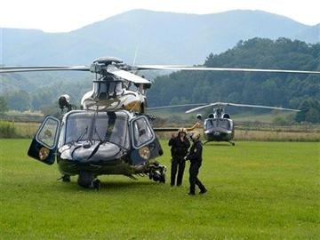 (AP photo/The News Leader, Mike Tripp). The flight crew for a Maryland State Police helicopter prepares to take off from the mobile command center in Deerfield, Va., on Wednesday, Aug. 27, 2014.