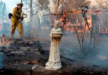 (AP Photo/The Fresno Bee, Mark Crosse). A religious statue is almost all that is left from a home that burned to the ground on Cedar Dr. in Oakhurst, Calif., Sunday, Sept. 14, 2014.