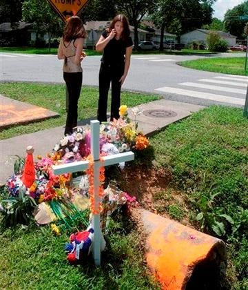 (AP Photo/The Houston Chronicle, Steve Campbell). In this June 29, 2004 photo Amber Webber, left, and Jami Majszak Flowers, who knew Logan Jones, visit a memorial for Jones, 13, at the storm drain where he died in Houston, Texas.
