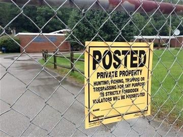 "(AP Photo/Adam Beam). In this Aug. 8, 2014 photo,A fence marked ""private property"" guards what was once the George F."
