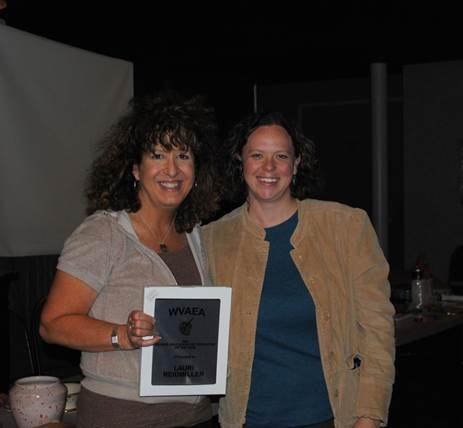 Dr. Lauri Reidmiller (left) receives the Higher Education Art Educator of the Year Award  from WVAEA president-elect Jennifer Yerdon LeJeune.