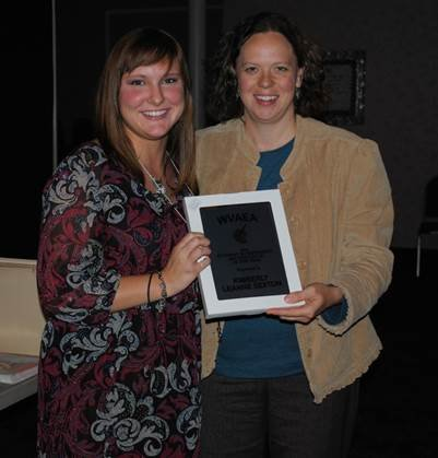 Kimberly Sexton (left) receives the Higher Education Art Education Student of the Year Award  from WVAEA president-elect Jennifer Yerdon LeJeune.