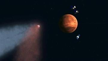 (AP Photo/NASA/JPL). This handout artist's concept provided by NASA/JPL shows the Comet Siding Spring approaching Mars, shown with NASA's orbiters preparing to make science observations of this unique encounter.