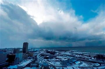 (AP Photo/The Buffalo News, Derek Gee). A massive band of lake effect snow moves through the south of Buffalo, N.Y. on Tuesday, Nov. 18, 2014.