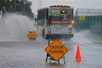 (AP Photo/Eric Risberg). A bus passes through a flooded roadway Thursday, Dec. 11, 2014, in Mill Valley, Calif.
