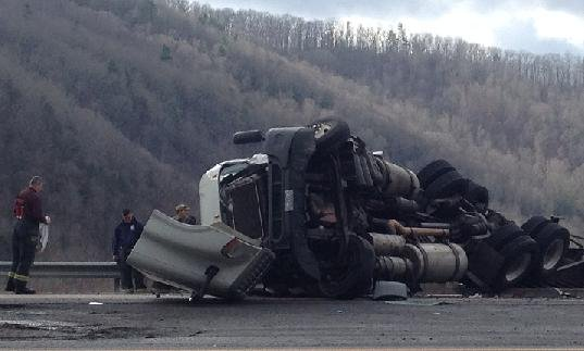A tractor trailer flips over on Interstate 77 in Mercer County on Tuesday.