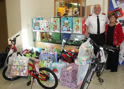 Bluefield Salvation Army Lieutenant Howard Hoffman and Campus Corner Bookstore Manager Jane Richardson are pictured as the gifts were picked up shortly before Christmas.
