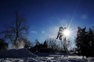 (AP Photo/Argus Leader, Joe Ahlquist). Despite subzero temperatures, Salvador Aleman, 16, of Sioux Falls, does a trick off a jump while snowboarding on Wednesday, Jan. 7, 2015, at Terrace Park in Sioux Falls, S.D.