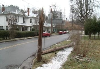 A telephone poll is snapped in half following a single-car crash in Bluefield, VA.