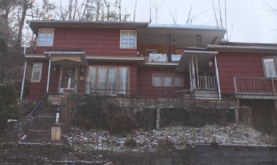 Drug task force officers conduct a drug raid at a home on Route 16 in War, WV on Friday. Two men were arrested during the raid.
