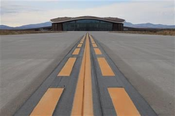 (AP Photo/Susan Montoya Bryan). This Dec. 9, 2014, image shows the taxiway leading to the hangar at Spaceport America in Upham, N.M.